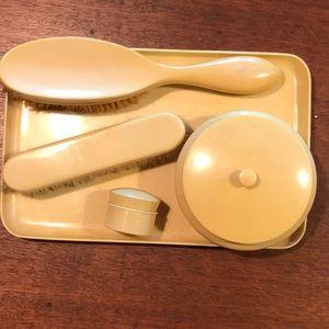 7 pc. vanity set. Warm butter creamy color antique